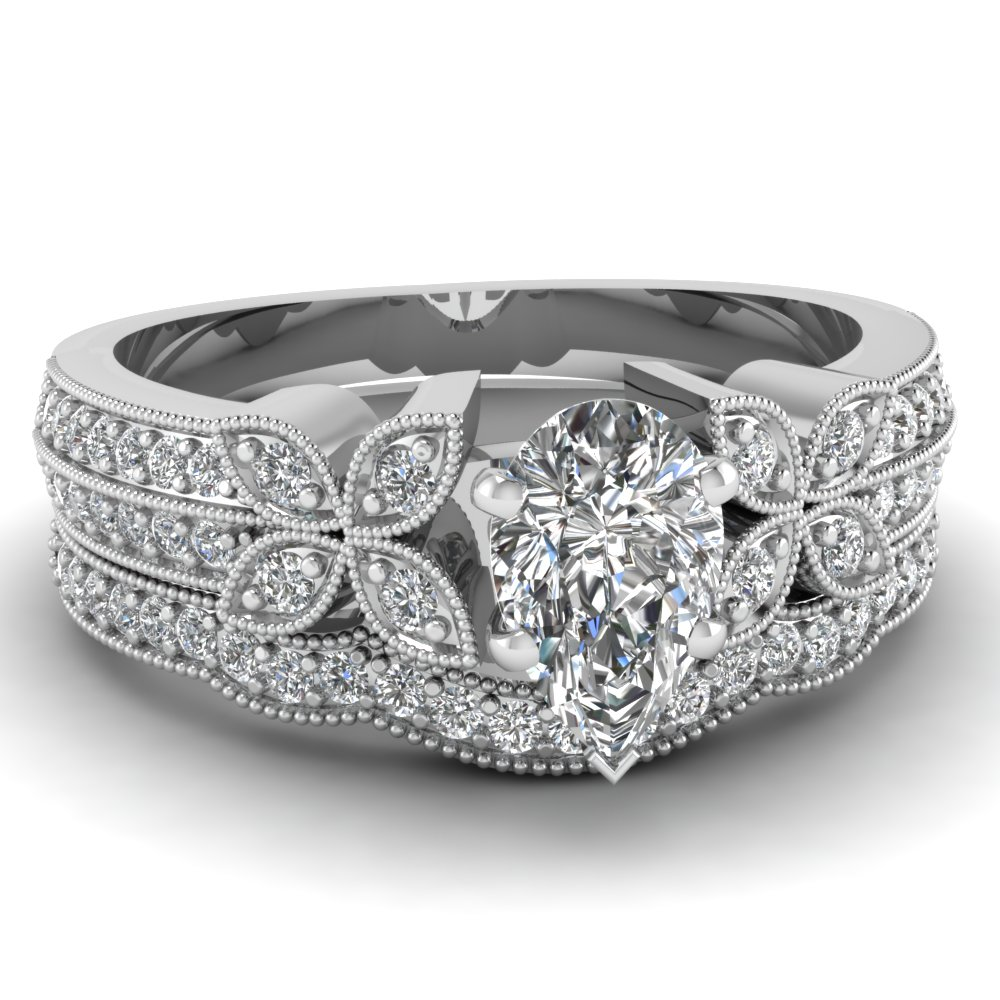 Pear Shaped Diamond Engagement Rings With White Diamonds In Platinum Platinum